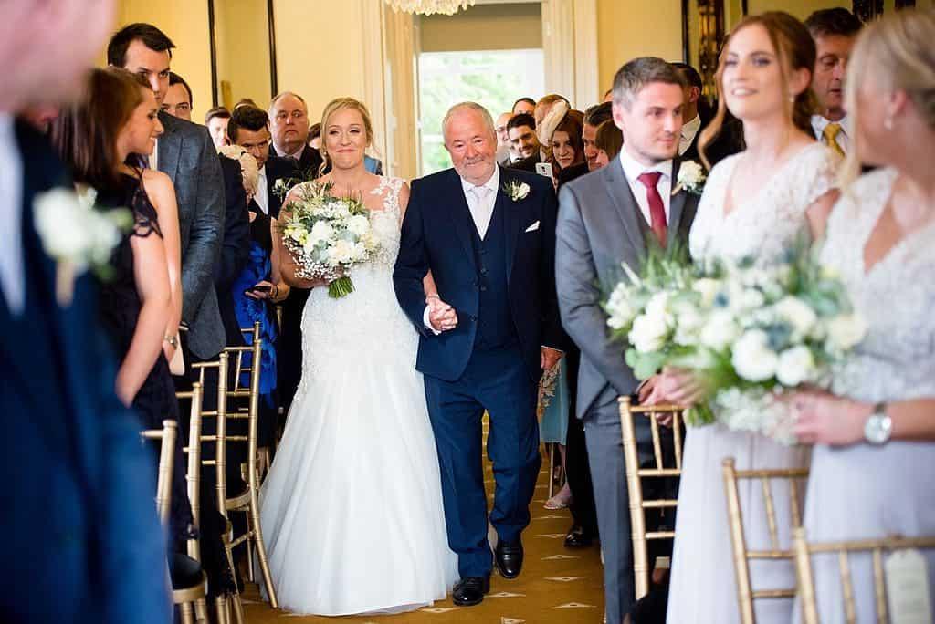 Bride walking down aisle at Shottle Hall