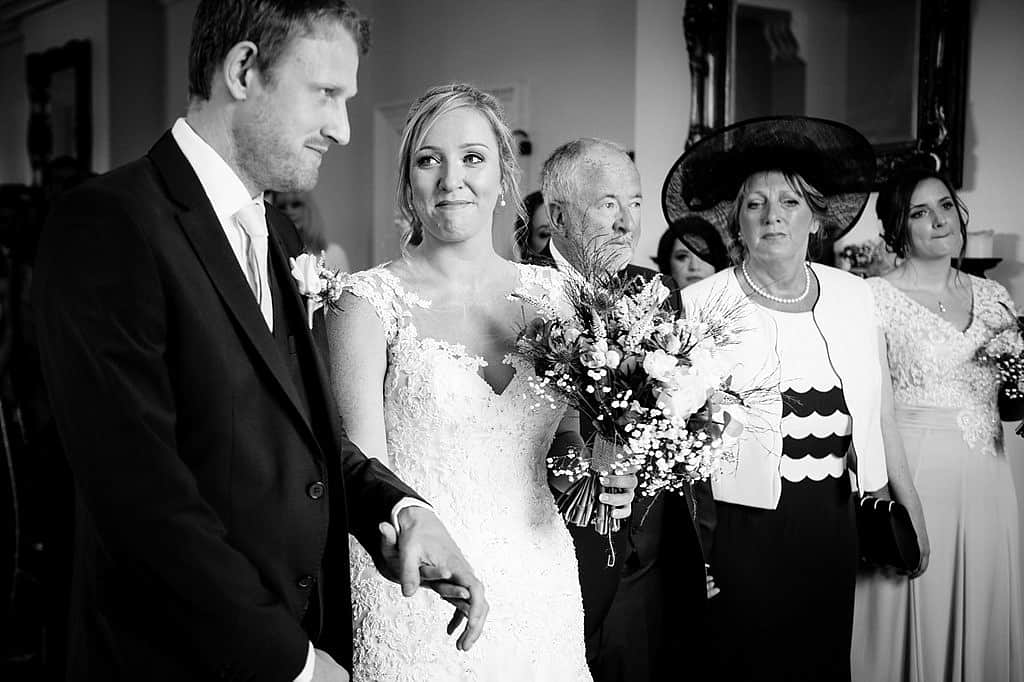 bride and groom saying I do at Shottle Hall