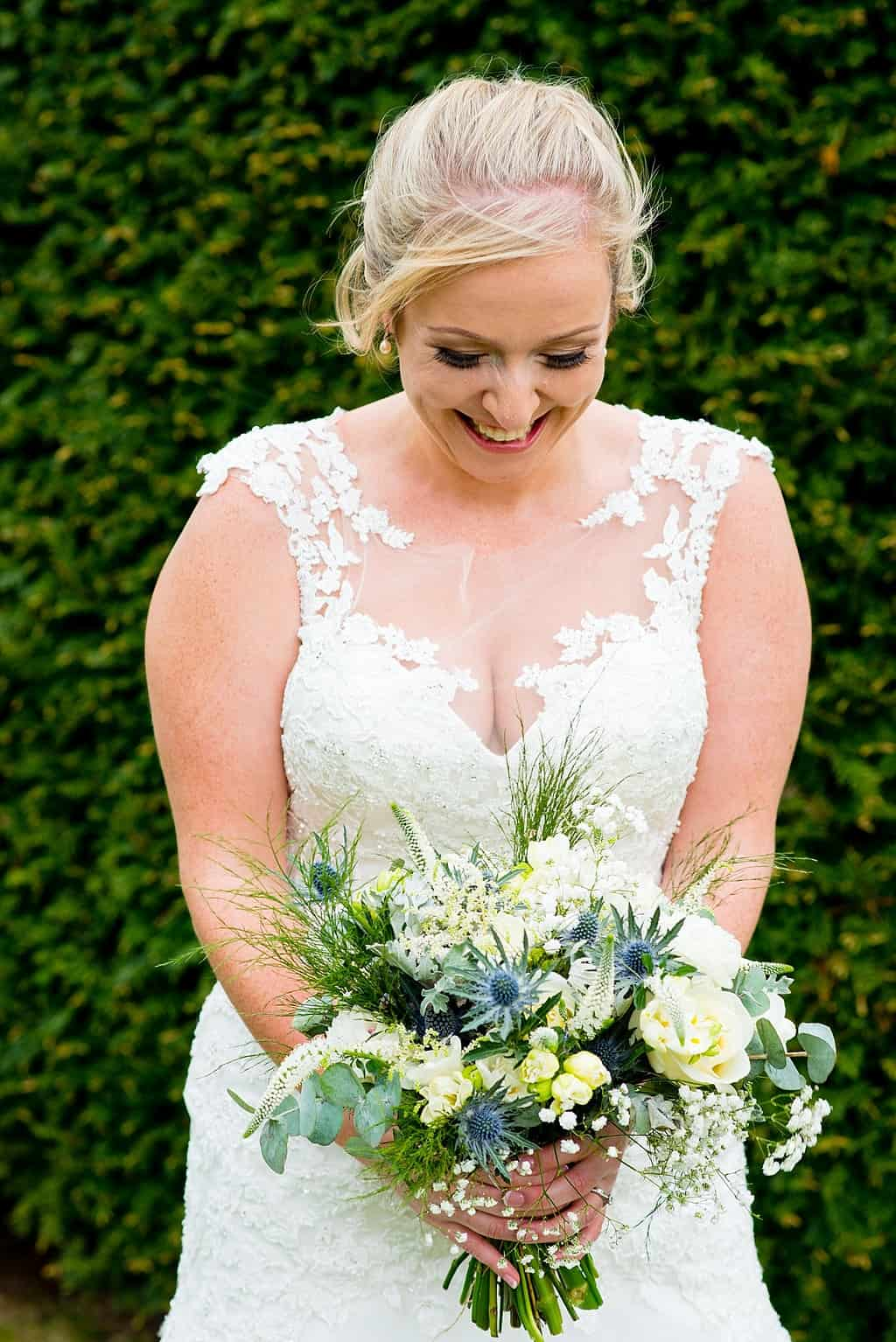 Beautiful bride with bouquet of white and green flowers