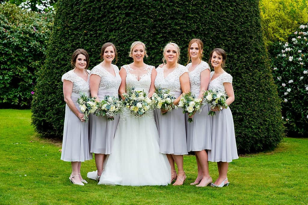 bride and bridesmaids pastel and lace dresses