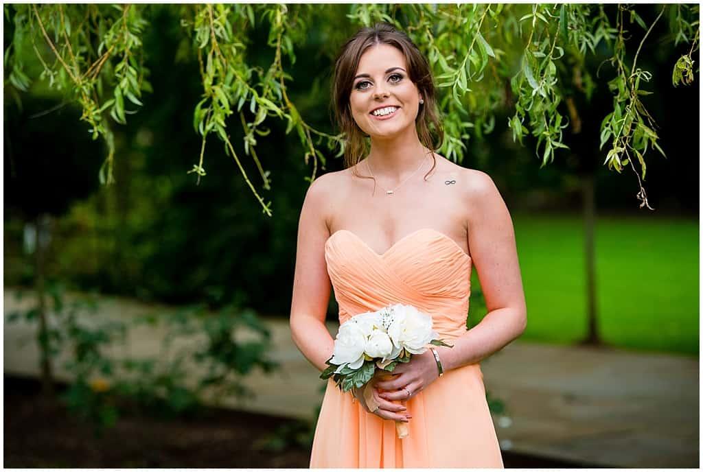 Strapless peach bridesmaids dress