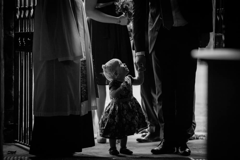 Flower girl at the church at a wedding