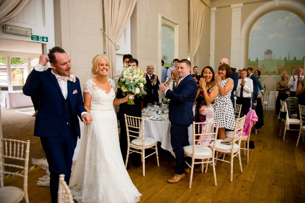 Bride and groom entering the wedding breakfast room at Norwood park
