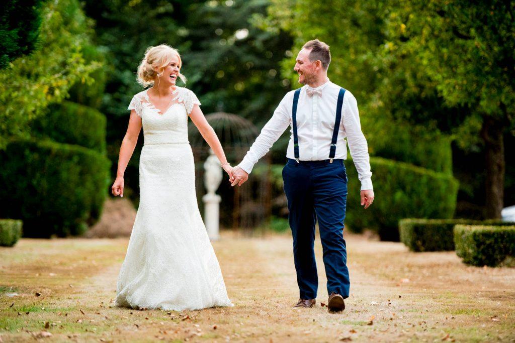 Bride and Groom walking wedding photographer