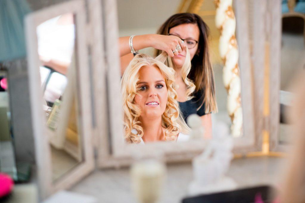 Make up artist and bride at a wedding