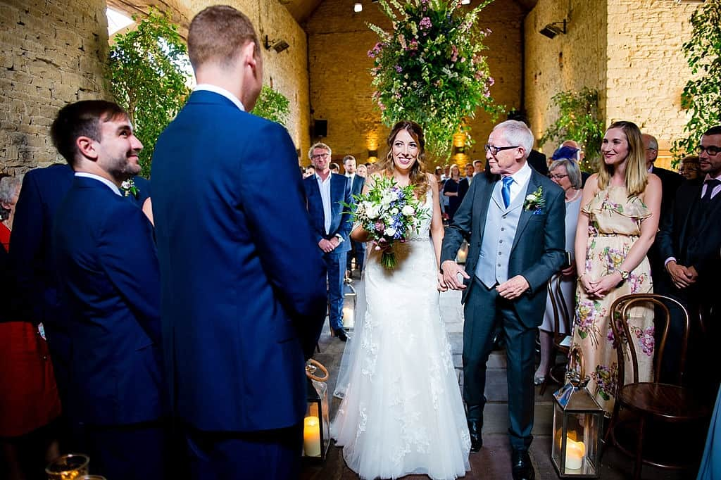Father walking bride down aisle at Cripps Barn