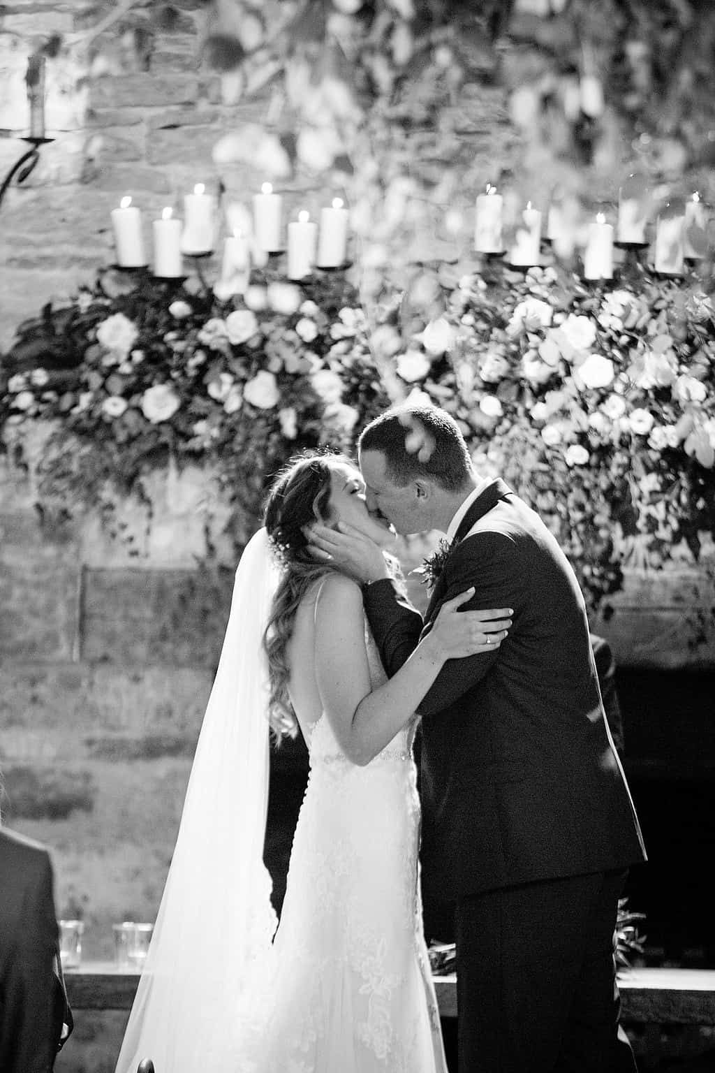 Bride & Groom first kiss at Cripps Barn