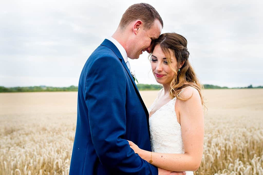 Bride and groom in corn field, Cotswold