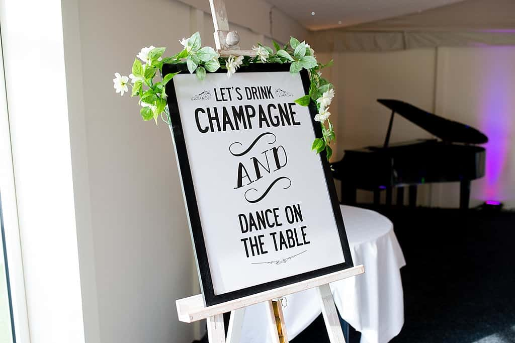 drink champagne and dance on the table sign