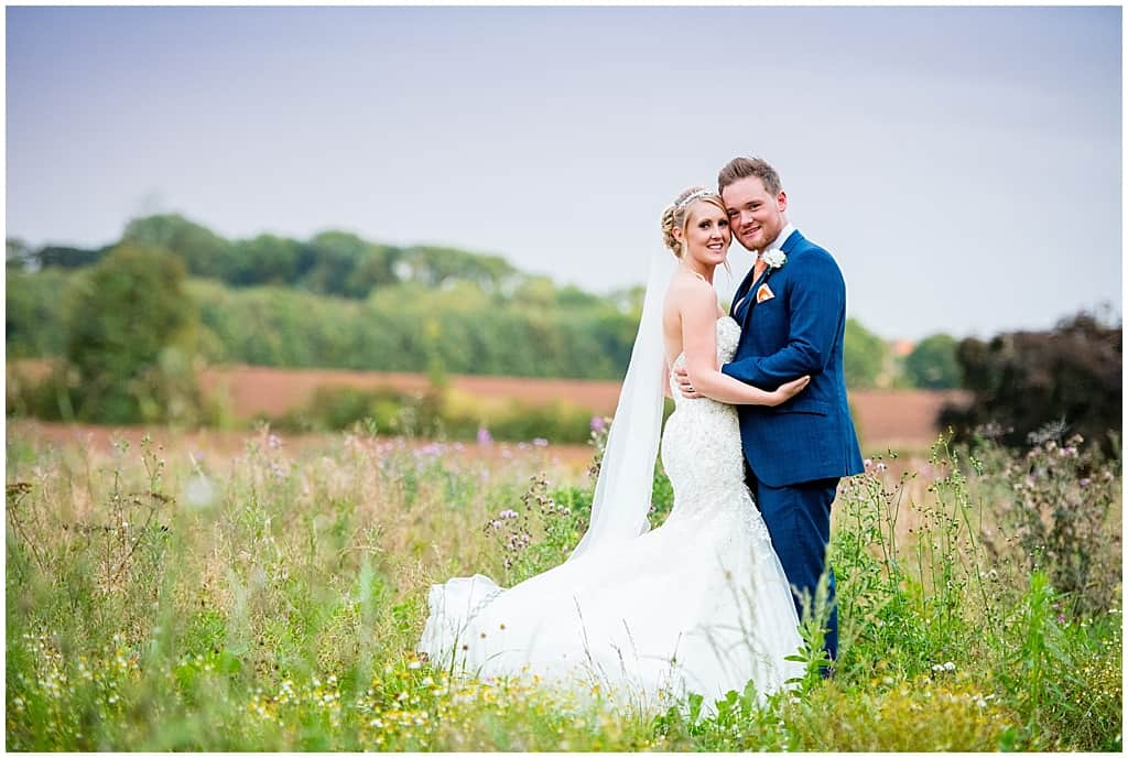 Bride and Groom Portraits in a field