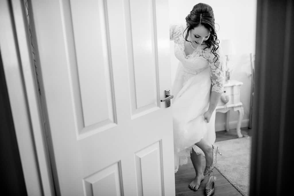 Bride getting in to her dress