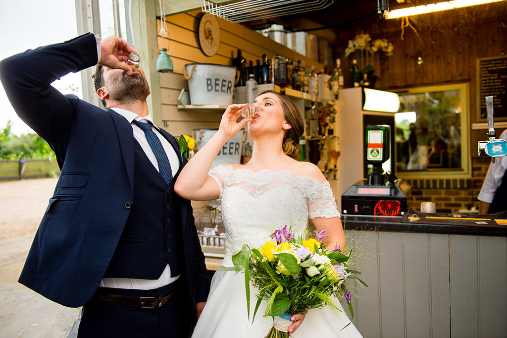 Bride and groom doing shots